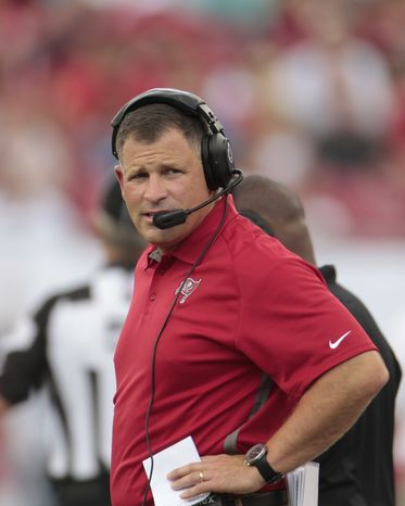 Tampa Bay Buccaneers head coach Greg Schiano watches as his team takes the lead on the Carolina Panthers.  The Buccaneers defeated the Panthers 16-10 in an NFL game on Sunday, Sept. 9, 2012, in Tampa, Fla. (AP Photo/Margaret Bowles)