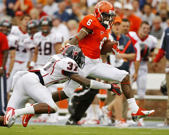 Virginia's Darius Jennings (6) runs for a touchdown past Richmond's Reggie Barnette (37) after a first quarter reception during an NCAA college football game, Saturday, Sept. 1, 2012, in Charlottesville, Va. Virginia won 43-19. (AP Photo/Richmond Times-Dispatch, Mark Gormus)
