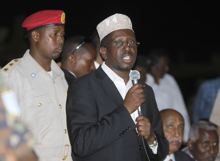 ** FILE ** Somali President Sharif Sheik Ahmed speaks during the swearing-in ceremony of 211 members of Parliament at the Aden Ade International Airport in Mogadishu, Somalia, on Monday, Aug. 20, 2012. Mr. Ahmed lost a parliamentary election for president to Hassan Sheikh Mohamud, a professor, on Monday, Sept. 10, 2012. (AP Photo/Farah Abdi Warsamehmeh)