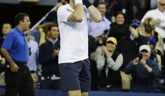 Britain's Andy Murray reacts after beating Serbia's Novak Djokovic in the championship match at the 2012 US Open tennis tournament, Monday, Sept. 10, 2012, in New York. (AP Photo/Darron Cummings)