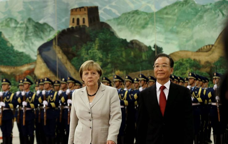 German Chancellor Angela Merkel (left) and and Chinese Premier Wen Jiabao walk together after inspecting a guard of honor during a welcome ceremony at the Great Hall of the People in Beijing on Thursday, Aug. 30, 2012. (AP Photo/Ng Han Guan)
