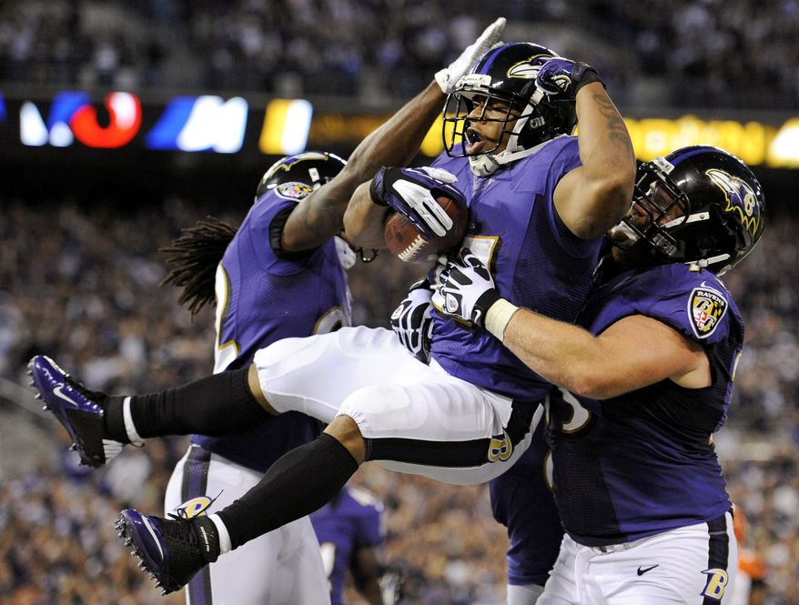 Baltimore Ravens running back Ray Rice, center, celebrates his touchdown with Torrey Smith, left, and Marshal Yanda in the first half of an NFL football game against the Cincinnati Bengals in Baltimore, Monday, Sept. 10, 2012. (AP Photo/Nick Wass)