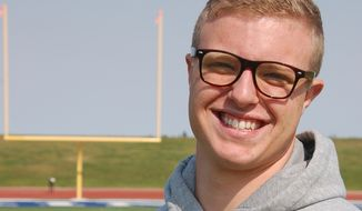 Jamie Kuntz poses for a photograph at a football field in Dickinson, N.D., on Tuesday, Sept. 11, 2012. Kuntz says he was kicked of the North Dakota State College of Science football team for being gay. School officials say he was dismissed from the team for lying to a coach. (AP Photo/James MacPherson)
