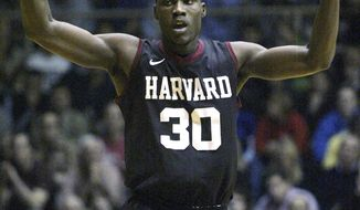 FILE - In Feb. 10, 2012, file photo, Harvard's Kyle Casey (30) celebrates after he scored against Penn in the first half of an NCAA college basketball game in Philadelphia. Casey plans to withdraw from school amid a cheating scandal that also may involve other athletes, according to several reports. Sports Illustrated and the Harvard Crimson reported Tuesday that Casey, a senior, would withdraw in an attempt to preserve a year of eligibility once the issue is resolved. (AP Photo/H. Rumph Jr, File)