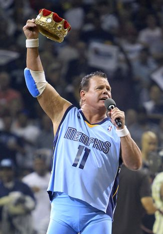 FILE - This April 23, 2011 file photo shows professional wrestler Jerry Lawler gesturing to fans before the start of Game 3 of a first-round NBA basketball series between the Memphis Grizzlies and the San Antonio Spurs, in Memphis, Tenn. Lawler collapsed during a World Wrestling Entertainment event on Monday night, Sept. 10, 2012 in Montreal. A statement from the WWE said that Lawler suffered a heart attack at the announcers' table and was taken from the Bell Centre to a hospital. (AP Photo/Mark Humphrey, File)
