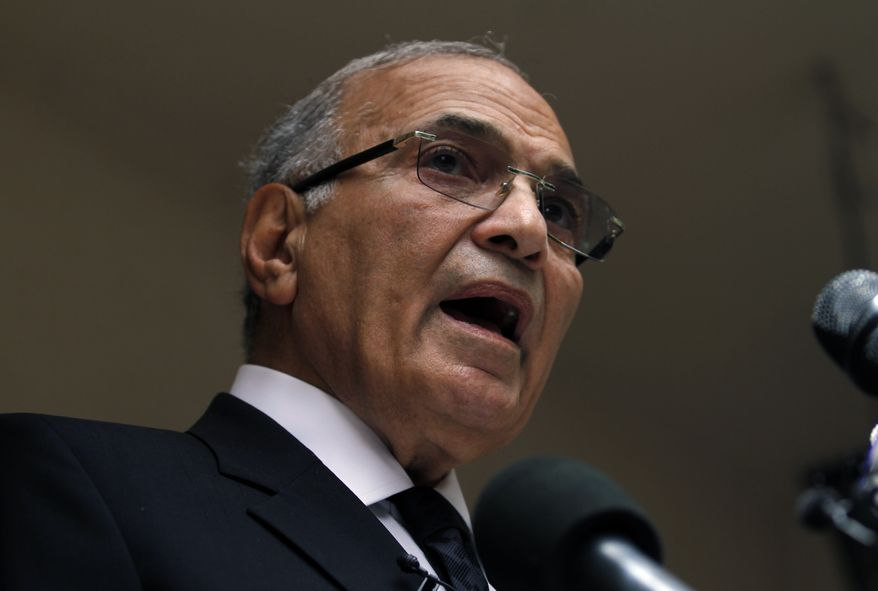 ** FILE ** Egyptian presidential candidate Ahmed Shafiq, who was ousted President Hosni Mubarak's last prime minister, speaks during a press conference at his office in Cairo on Saturday, May 26, 2012. (AP Photo/Khalil Hamra)