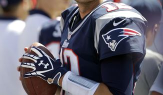 New England Patriots quarterback Tom Brady watches from the sideline in the third quarter of an NFL football game against the Tennessee Titans, Sunday, Sept. 9, 2012, in Nashville, Tenn. Brady threw for 236 yards and two touchdowns as the Patriots won 34-13. (AP Photo/Wade Payne)
