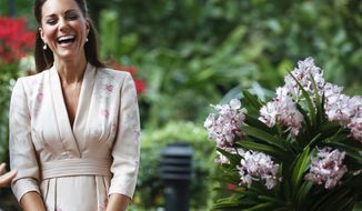 Kate, Duchess of Cambridge, smiles Sept. 11, 2012, during a ceremony naming a hybrid orchid in their honor at the Orchid Garden within the Singapore Botanical Gardens in Singapore. The Duke and Duchess of Cambridge are on an official three-day trip to Singapore. (Associated Press)