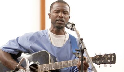 Robert Ross, 32, a full-time clerk and a leader in the seminary training program, plays guitar during services at the California Rehabilitative Center chapel in Norco, Calif. The program is being introduced in other prisons.