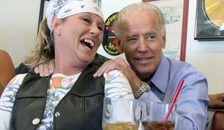 Vice President Joseph R. Biden visits with a patron over lunch at Cruisers Diner in Seaman, Ohio. Politicians have always tried to connect with voters, but the 2012 candidates are putting their all into the campaign cliche of pressing the flesh. (Associated Press)
