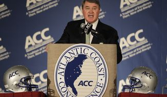 FILE - This July 22, 2012 file photo shows Atlantic Coast Conference commissioner John Swofford speaking to the media during the conference's college football kickoff news conference in Greensboro, N.C. Notre Dame is leaving the Big East for the Atlantic Coast Conference in all sports but football.The ACC said Wednesday, Sept. 12, 2012, the school will play five football games annually against the league's programs, but will be a full member in all other sports. (AP Photo/Chuck Burton, File)