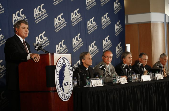 Atlantic Coast Conference Commissioner John Swofford, left, speaks during a news conference at the University of North Carolina in Chapel Hill, N.C., Wednesday, Sept. 12, 2012, where Notre Dame was announced as an addition to the conference. Notre Dame comes as close as it ever has in surrendering its independence in football, agreeing to play five games against the league's programs every year and joining the burgeoning league in all other sports. (AP Photo/Gerry Broome)