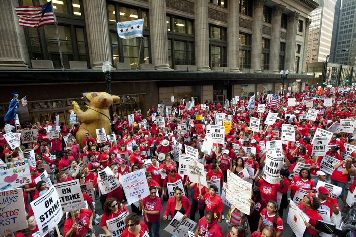 Thousands of teachers rally for the second consecutive day outside the Chicago Board of Education headquarters on Tuesday, Sept. 11, 2012, in Chicago. Teachers walked off the job Monday for the first t