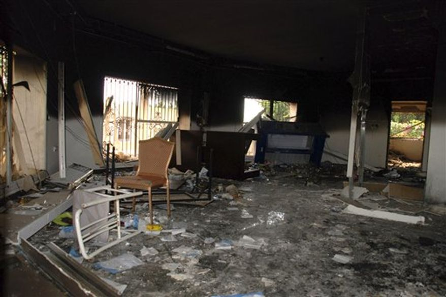 Glass, debris and overturned furniture are strewn inside a room in the gutted U.S. Consulate in Benghazi, Libya, on Wednesday, Sept. 12, 2012, after an attack the previous day killed four Americans, including Ambassador J. Christopher Stevens. (AP Photo/Ibrahim Alaguri)