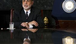 **FILE** Federal Reserve Chairman Ben Bernanke speaks Aug. 7, 2012, to educators in the board room of the Federal Reserve in Washington during a town hall meeting. (Associated Press)
