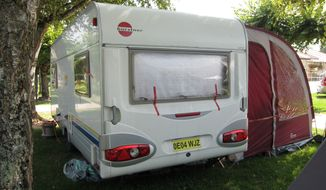 Members of a British-Iraqi family were found slain in this camper parked near Annecy, France. (AP Photo/Lionel Cironneau)