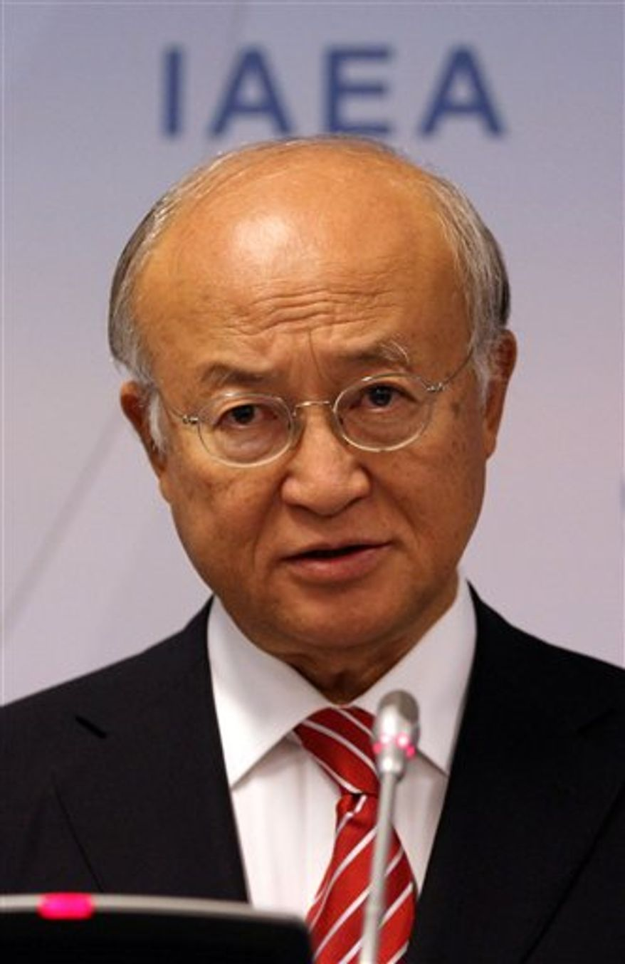Director General of the International Atomic Energy Agency, IAEA, Yukiya Amano of Japan addresses the media during a news conference after a meeting of the IAEA board of governors at the International Center, in Vienna, Austria, Monday, Sept. 10, 2012. (AP Photo/Ronald Zak)