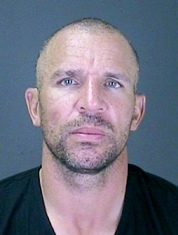 In this photo released by the Southampton, N.Y. Police, Monday, July 16, 2012, New York Knicks' Jason Kidd is shown following his arrest. Kidd intends to fight a charge that he was drunk when he crashed his SUV into a telephone pole in the Hampton