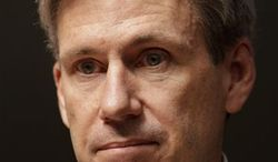 ** FILE ** In this Monday, April 11, 2011, file photo, U.S. envoy Chris Stevens stands in the lobby of the Tibesty Hotel where an African Union delegation was meeting with opposition leaders in Benghazi, Libya. (AP Photo/Ben Curtis, File)