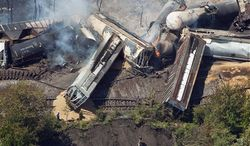 ** FILE ** This July 11, 2012, aerial file photo shows a freight train after an early morning derailment in Columbus, Ohio. Part of the freight train carrying ethanol derailed and caught fire, shooting flames skyward into the darkness and prompting the evacuation of a mile-wide area as firefighters and hazardous materials crews monitored the blaze. (AP Photo/The Columbus Dispatch, Eamon Queeney)