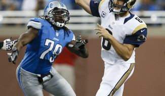 St. Louis Rams quarterback Austin Davis (9) passes the ball as Detroit Lions defensive end Willie Young (79) pressures him during an NFL game in Detroit, Sunday, Sept, 9, 2012. (AP Photo/Rick Osentoski)