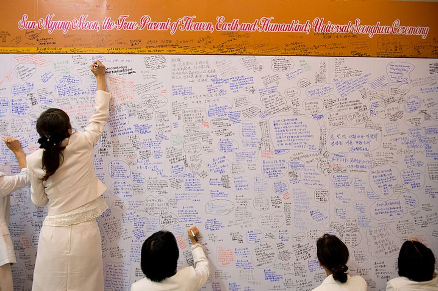 Mourners write messages for the family of the Rev. Sun Myung Moon inside the Cheongpyeong Heaven and Earth Training Center complex near Seoul, Korea on Wednesday, Sept. 12, 2012. These message walls are filled and must be replaced every day, according to officials. They will later be moved to the museum, which is inside the palace building on the complex. The church currently has members in 194 countries around the world. (Barbara L. Salisbury/The Washington Times)