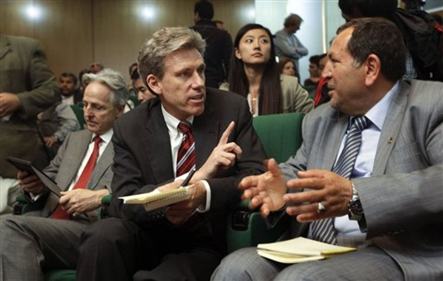 **FILE** U.S. envoy Chris Stevens (center), accompanied by British envoy Christopher Prentice (left), speaks April 11, 2011, to Council member for Misrata Dr. Suleiman Fortia (right) at the Tibesty Hotel where an African Union delegation was meeting with opposition leaders in Benghazi, Libya. (Associated Press)