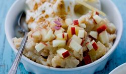 Caramelized Apple Ginger Rice Pudding topped with the best of fall fruit is a warm comfort food made even creamier with a risotto technique. (Associated Press)