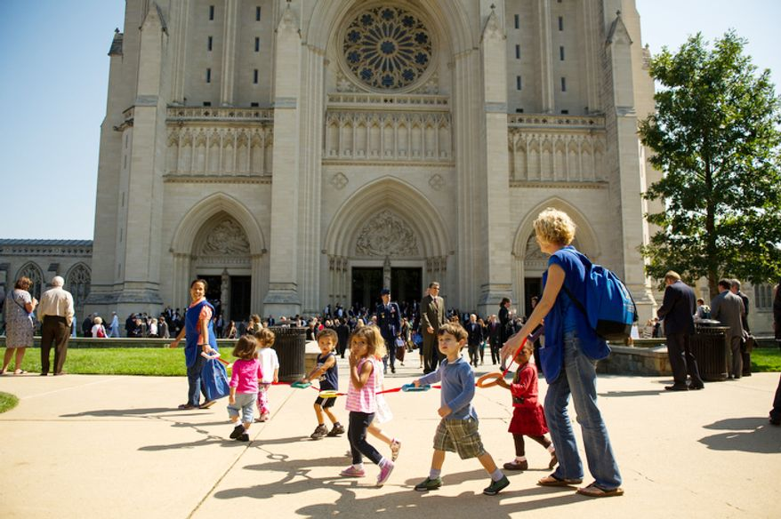 Children walk past the National Cathedral as attendees file out of the cathedral following a memorial service for Neil Armstrong, Washington, D.C., Thursday, September 13, 2012. (Andrew Harnik/The Washington Times)