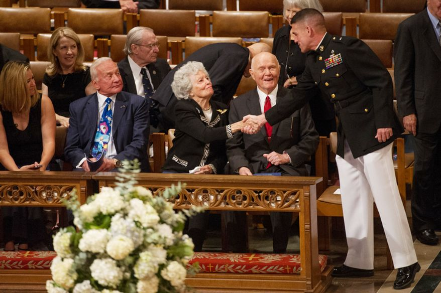 Astronaut Buzz Aldrin, second from left, watches as Annie Glenn, third from left, and her husband, astronaut and Sen. John Glenn (D-Ohio), second from right, are greeted by a marine before the start of the memorial service for Neil Armstrong. (Andrew Harnik/The Washington Times)