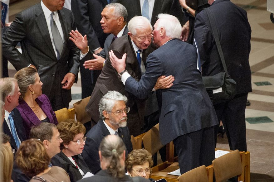 Congressman Ralph hall (R-Texas), center, is greets by astronaut Capt. Eugene Cernan, center, right, as NASA Administrator Charles Bolden, center left, greets others before the memorial service for Neil Armstrong. (Andrew Harnik/The Washington Times)