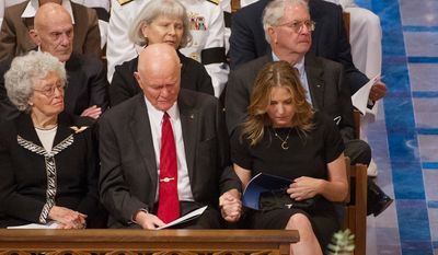 "Annie Glenn, left, the wife of astronaut Sen. John Glenn (D-Ohio), second from left, watches as Glenn holds the hand of singer Diana Krall, right, as she returns to her seat after performing ""Fly Me to The Moon"" during the memorial service for Neil Armstrong at the National Cathedral2. (Andrew Harnik/The Washington Times)"