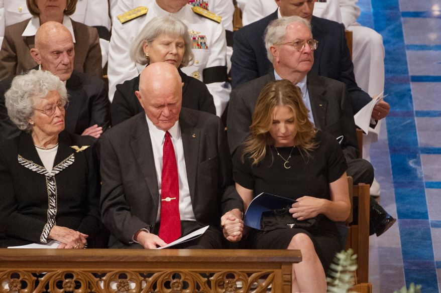 """Annie Glenn, left, the wife of astronaut Sen. John Glenn (D-Ohio), second from left, watches as Glenn holds the hand of singer Diana Krall, right, as she returns to her seat after performing """"Fly Me to The Moon"""" during the memorial service for Neil Armstrong at the National Cathedral2. (Andrew Harnik/The Washington Times)"""