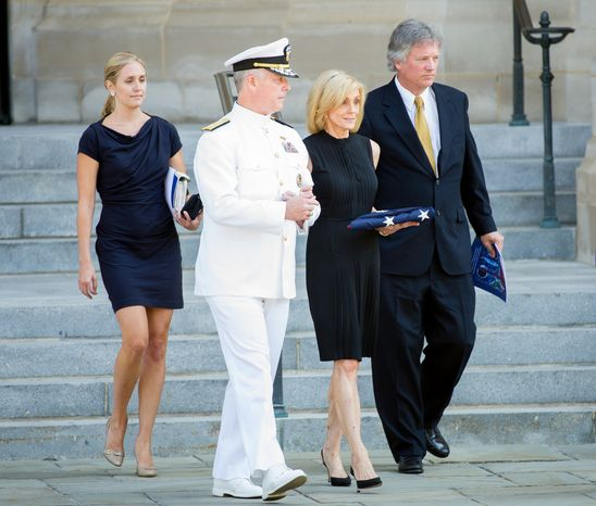 Carol Armstrong, wife of Neil Armstrong, second from right, is escorted out of the National cathedral following a memorial service for Neil Armstrong, Washington, D.C., Thursday, September 13, 2012. (Andrew Harnik/The