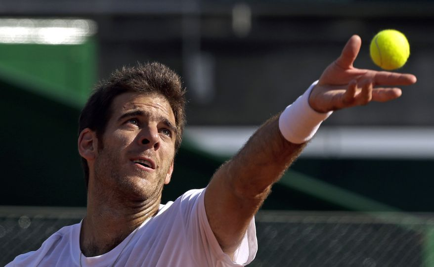 Argentina's Juan Martin del Potro serves during a practice session in Buenos Aires, Argentina, Wednesday, Sept. 12, 2012. Slowed by an injury to his left wrist, del Potro is expected to play when Argentina opens its Davis Cup tennis semifinal against the Czech Republic on Friday. (AP Photo/Natacha Pisarenko)