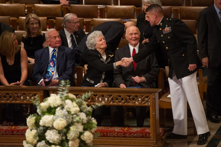 Astronaut Buzz Aldrin (second from left) watches as Annie Glenn (third from left) and her husband, astronaut and Ohio Sen. John Glenn (second from right), are greeted Sept. 13, 2012, by a Marine before the start of the memorial service for Neil Armstrong at the National Cathedral in Washington. (Andrew Harnik/The Washington Times)