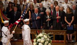 From left: Astronaut Buzz Aldrin, Annie Glenn and her husband, astronaut and Ohio Sen. John Glenn, and singer Diana Krall watch Sept. 13, 2012, as the flags are marched into the memorial service for Neil Armstrong at the National Cathedral in Washington. (Andrew Harnik/The Washington Times)