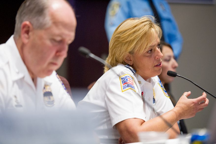 D.C. Police Chief Cathy L. Lanier and Prince George's County Police Chief Mark Magaw deliver new crime statistics for the D.C. metropolitan area to the Metropolitan Washington Council of Governments on Wednesday, Sept. 12, 2012. (Andrew Harnik/The Washington Times)