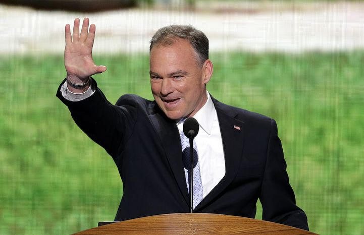 **FILE** Former Virginia Gov. Tim Kaine waves to the delegates from Virginia before addressing the Democratic National Convention in Charlotte, N.C., on Sept. 4, 2012. (Associated Press)