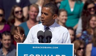 President Obama speaks at a campaign rally in Golden, Colo., Thursday, Sept. 13, 2012. (AP Photo/Ed Andrieski)
