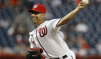 Washington Nationals' starting pitcher Gio Gonzalez delivers the pitch to the Chicago Cubs in the first inning during their baseball game at Nationals Park, Wednesday, Sept. 5, 2012, in Washington. (AP Photo/Richard Lipski)