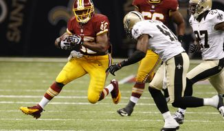 ** FILE ** Washington Redskins running back Alfred Morris (46) rushes past New Orleans Saints strong safety Roman Harper (41) in the second half of an NFL football game at the Mercedes-Benz Superdome in New Orleans on Sunday, Sept. 9, 2012. (AP Photo/Bill Haber)