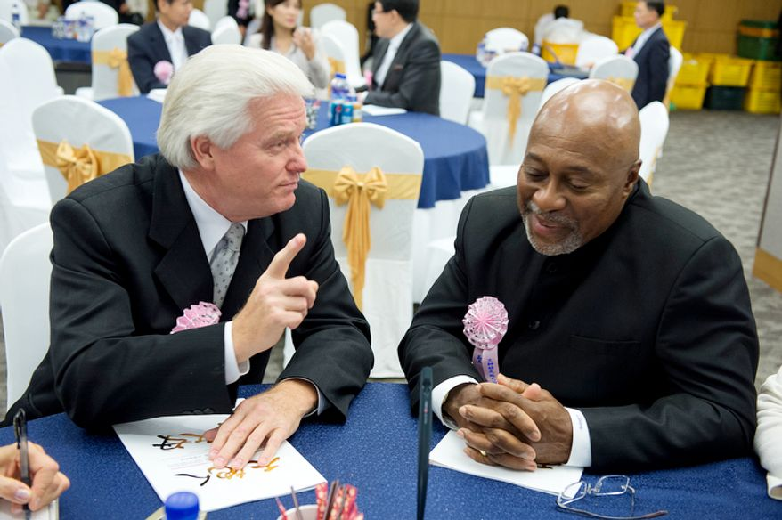 Bishop Jesse Edwards, left, from Philadelphia, Penn., and Archbishop Augustus Stallings Jr. from Washington, D.C., who are co-presidents of the American Clergy Leadership Conference, both felt it was important to travel to Korea for the funeral of the late Rev. Sun Myung Moon. (Barbara L. Salisbury/The Washington Times)