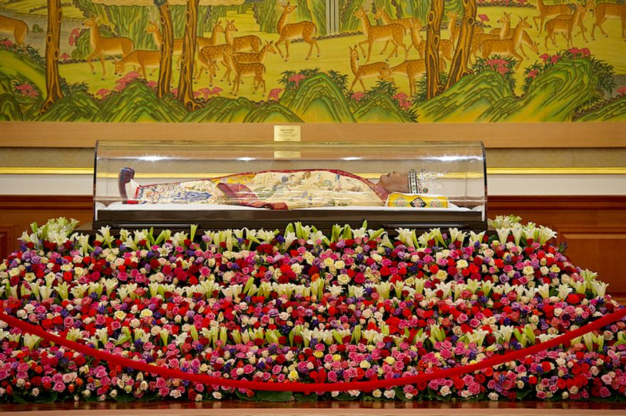 """The body of the late Rev. Sun Myung Moon lies at the palace in the Cheong Shim Peace World Center in Gapyeong-gun, Korea on Thursday, Sept. 13, 2012. Mourners are invited to come pay tribute to the """"True Father,"""" offering him prayers and paying respect to his family. His 13-day mourning period culminates on Saturday with an official funeral service. (Barbara L. Salisbury/The Washington Times)"""