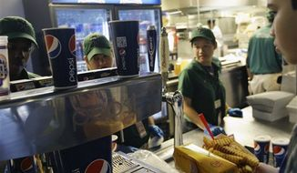 Emilio Cordova (right) chooses a soft drink during a baseball game between the New York Mets and the Washington Nationals on Wednesday, Sept. 12, 2012, in New York. (AP Photo/Frank Franklin II)