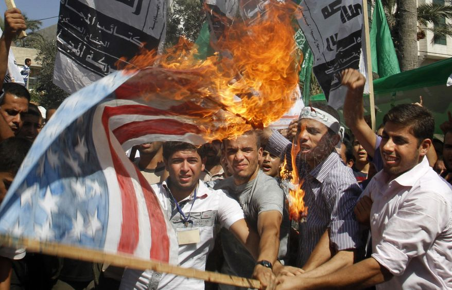 Palestinian Hamas supporters burn a U.S. flag during a protest in Gaza City, Friday, Sept. 14, 2012 as part of widespread anger across the Muslim world about a film ridiculing Islam's Prophet Muhammad. (AP Photo/Hatem Moussa)