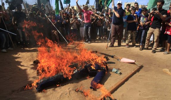 Palestinian Islamists burn an effigy portraying U.S. President Barack Obama  during a protest about a film ridiculing Islam's Prophet Muhammad in the Palestinian refugee camp of Ain el-Hilweh near Sidon, Lebanon, Friday, Sept. 14, 2012. (AP Photo/Mohammed Zaatari)