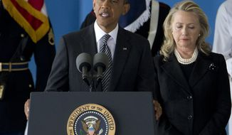 President Obama, accompanied by Secretary of State Hillary Rodham Clinton, speaks Sept. 14, 2012, during a ceremony at Andrews Air Force Base, Md., marking the return to the United States of the remains of the four Americans killed earlier in the week in Benghazi, Libya. (Associated Press)