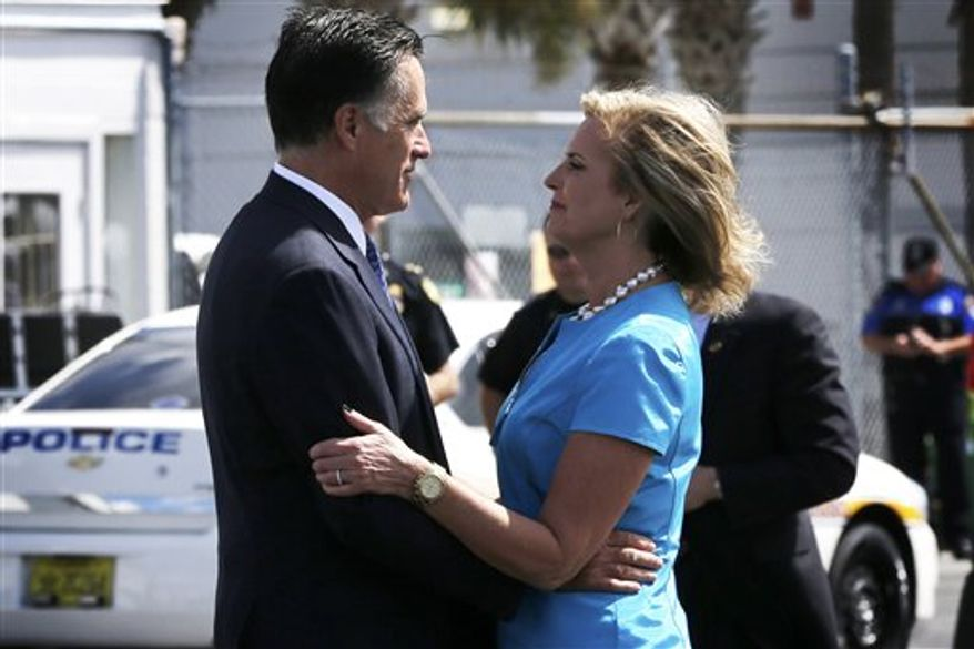 ** FILE ** Republican presidential candidate, former Massachusetts Gov. Mitt Romney, embraces his wife Ann before he boards his campaign charter plane in Jacksonville, Fla., Wednesday, Sept. 12, 2012. (AP Photo/Charles Dharapak)