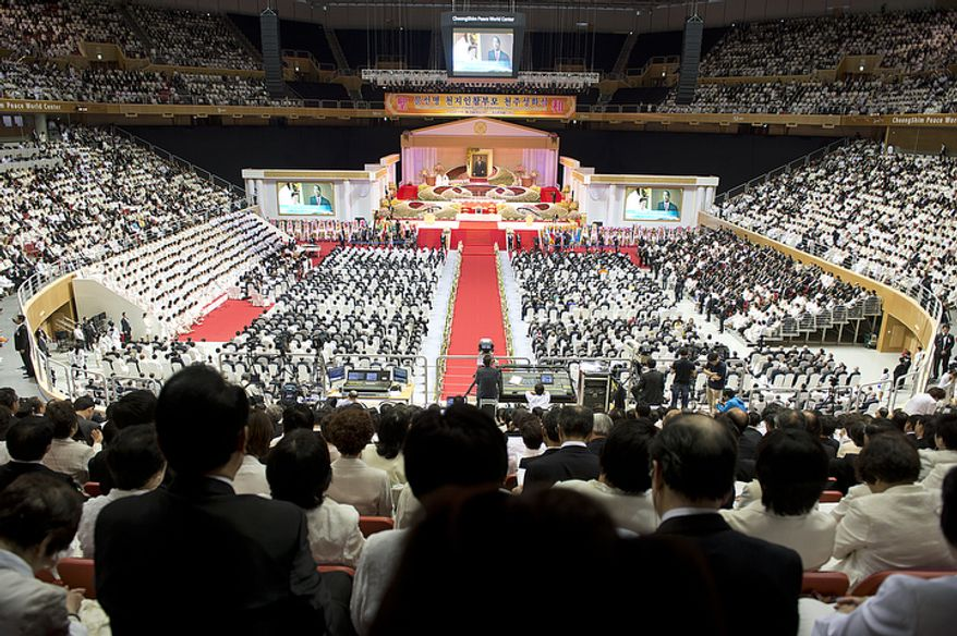 Thousands of people fill the stadium at the Cheong Shim Peace World Center in Gapyeong, Korea on Saturday, Sept. 15, 2012, for the seonghwa, or ascension, ceremony, known as the traditional funeral in western terms, for the late Rev. Sun Myung Moon. Some 15,000 people fit into the stadium, where the funeral was held, with another 10,000 to 15,000 expected to be watching live simulcasts around the complex. (Barbara L. Salisbury/The Washington Times)